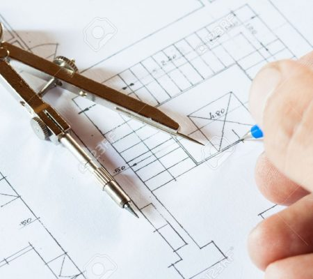 15430527-architect-drawing-a-construction-project